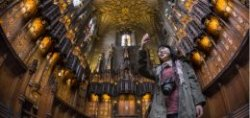 A visitor takes a picture inside the Chapel of the Order of the Thistle,  in St Giles' Cathedral,  Royal Mile,  Edinburgh
